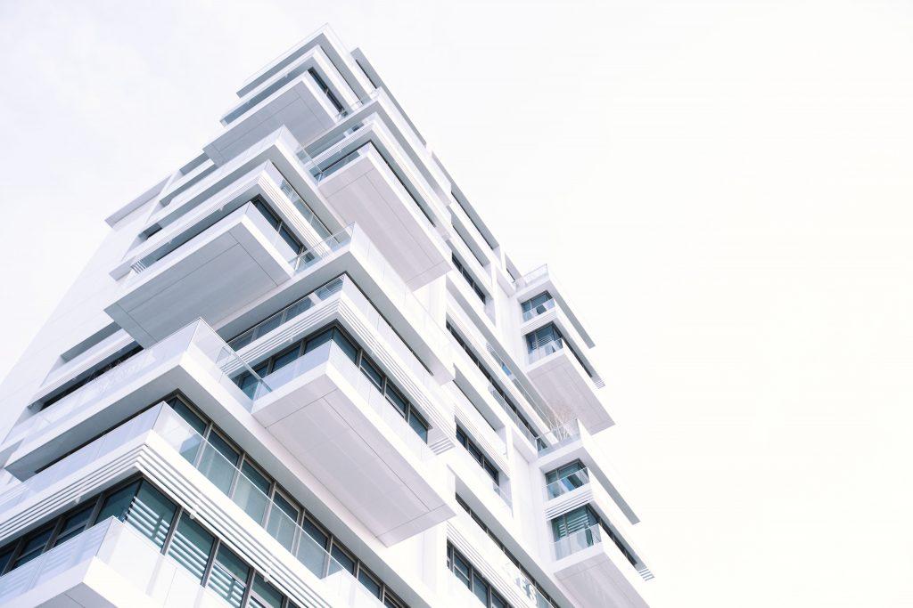 White condominium building with a modern design.