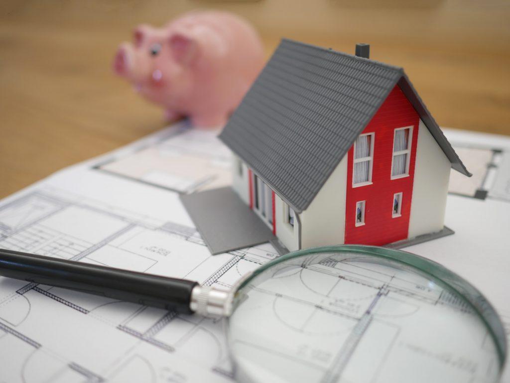 Piggy bank, floor plan, house, magnifying glass.